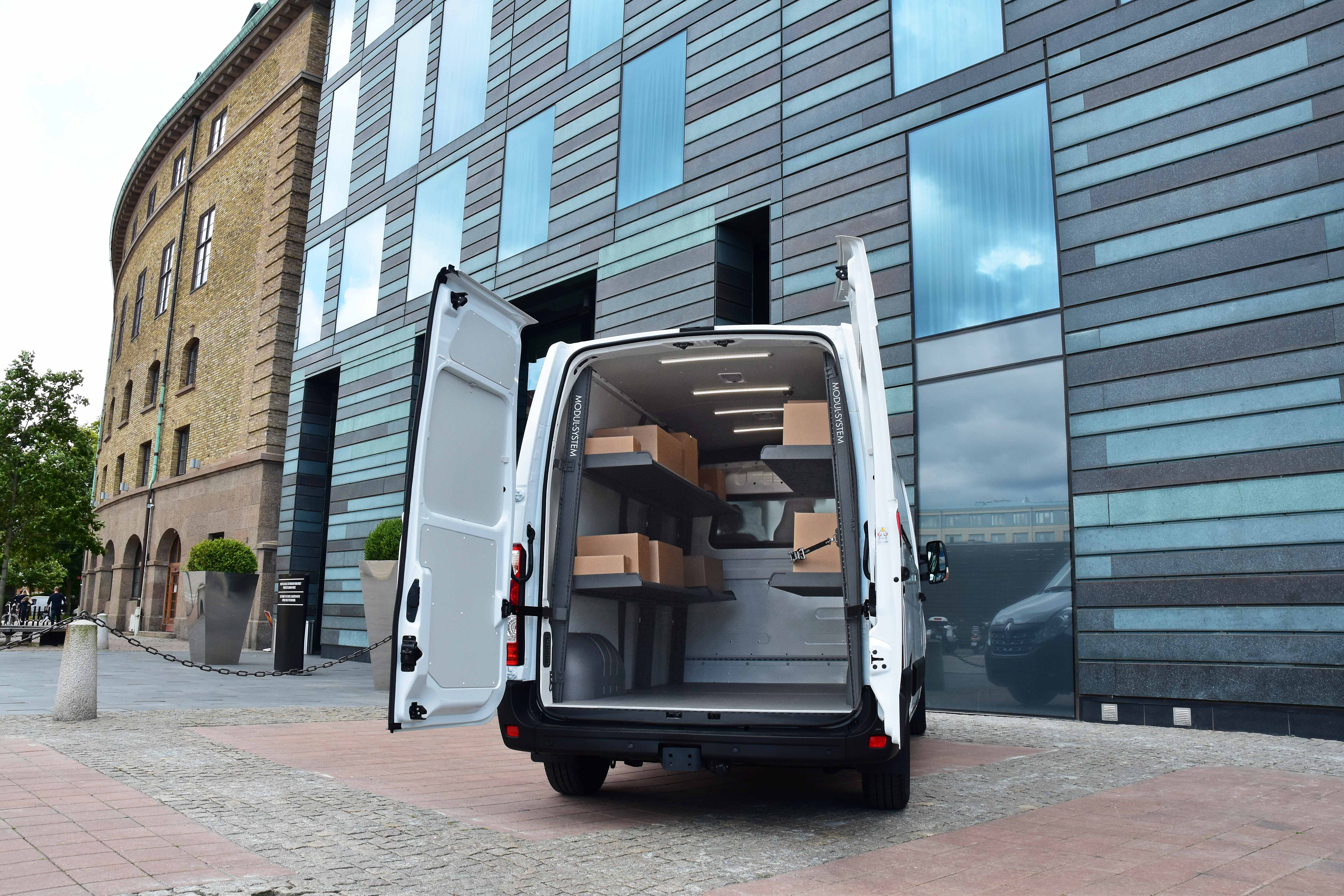 Van fitted out with modul-express van shelving holding delivery boxes