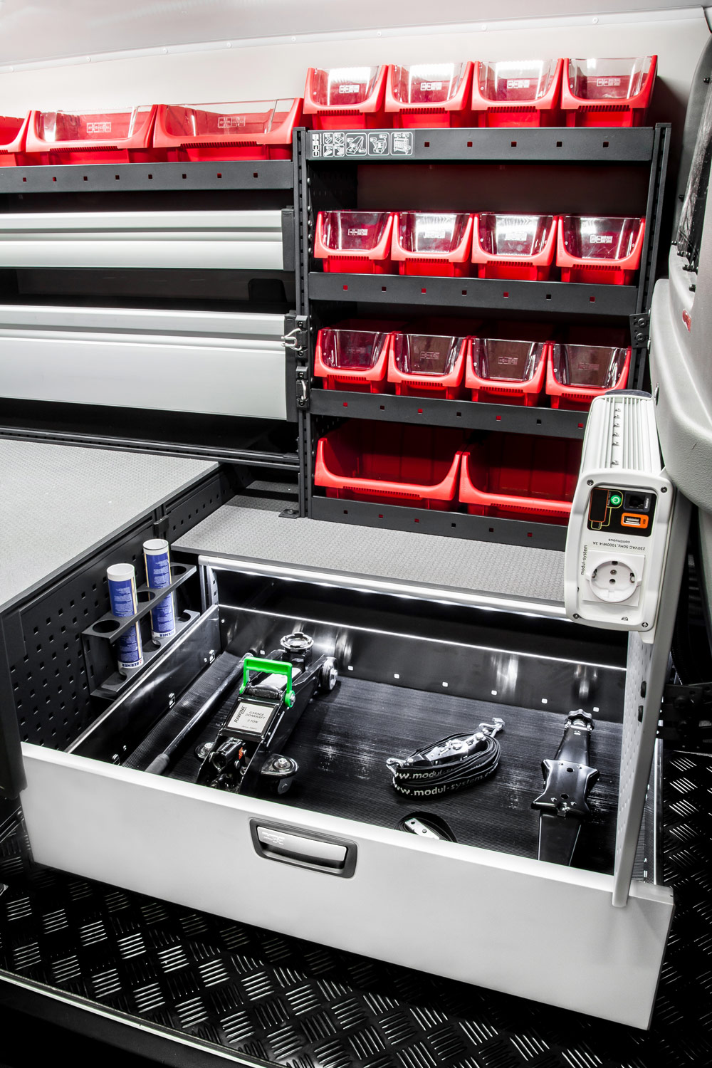 Example of modul-system drawer open with tools and storage boxes